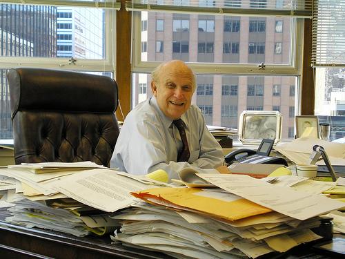 messy desk man photo