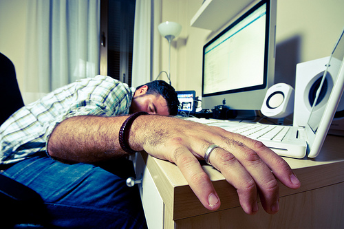 man sleeping desk photo